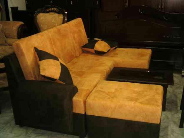 Sala l con puff en telas variadas palmira hogar for Casa muebles palmira