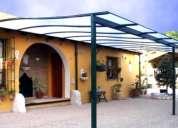 Amplìe local con pèrgolas, techos fijos y corredizos, en policarbonato alveolar. fotos.3108243077